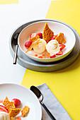 Cream cheese ice cream with strawberries and honeycomb