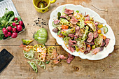 Roast beef salad with radishes, ginger and sesame seeds