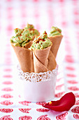 Prawn and avocado cream served in pastry cones