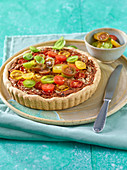 An aubergine and smoked tofu tart with tomatoes