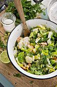 Warm salad with cauliflower and coconut prawns