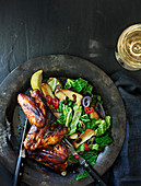 Caribbean marinated grilled chicken wings with savoy cabbage and mushrooms