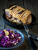 Roast pork with a red cabbage salad
