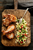 Pork chops with oriental apple and cabbage salad