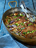 Pork chops with spring onions and mushrooms