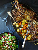 Roast lamb with potatoes, carrots, and spinach and rhubarb salad