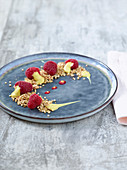 Coconut crumble with raspberries and mango mousse