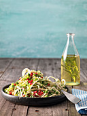Kohlrabi pasta with pomegranate seeds and pea and almond sauce