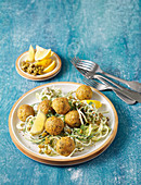 Lentil balls with garlic noodle nests