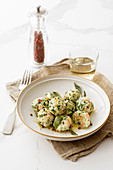 Ricotta dumplings with salmon and fresh herbs