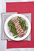 Marinated tuna fish on rocket salad