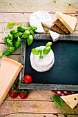 Italian cuisine: an arrangement of cheeses, tomatoes and basil