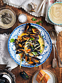 Mussels in white wine and vegetable broth with mayonnaise and garlic bread
