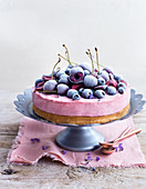 Cherry cream cheese cake with frozen cherries and blueberries