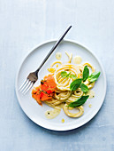 Spaghetti with smoked salmon, cream sauce and basil
