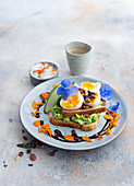 Toast with avocado purée, egg and cucumber