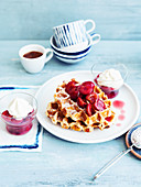 Waffles with sweet cherry compote and vanilla cream