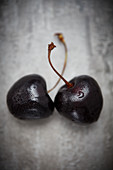 Two cherries with drops of water