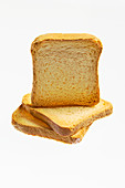 Three slices of zwieback (rusk) on white background