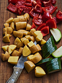 Potatoes, peppers and courgettes being sliced