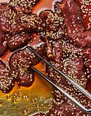 Steak strips in a sesame seed marinade