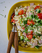 Noodle salad with cucumber, cherry tomatoes and ham