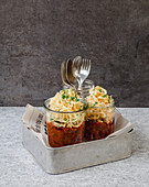 Vegetable noodles with chorizo sugo in jars