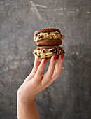 A hand holding two sugar-free nicecream sandwiches