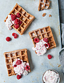 Sugar-free apple waffles with raspberry cream and rice syrup