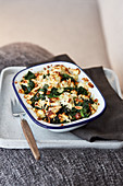 Spinach gratin with feta cheese and peanuts