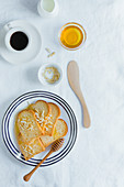 Melba toast with honey and chopped almonds