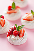 Mini pavlovas with whipped cream and berries
