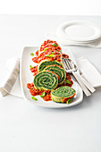 Spinach pasta rolls with tomato sauce