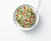 Rice salad with vegetables, tahini and lemon vinaigrette