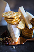 Crackers and various types of cheese