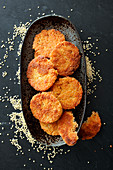 Millet fritters in a black bowl