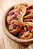 Cherry cookies in a wooden bowl