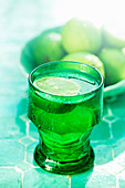 A glass of lime water