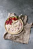 Sweet rice porridge pudding in ceramic plate with berries