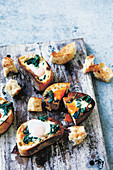 Pan fried slices of bread with spinach, feta and eggs