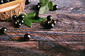 Blackcurrants on a wooden surface