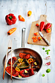 Roasted red, yellow and green peppers in a pan