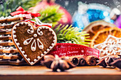 Christmas homemade gingerbread cookies with various decorations, red ribbon with happy christmas