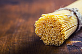 Bunch of spaghetti on wooden table