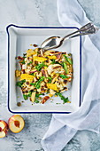 Roasted Cauliflower salad with peach, corn, lemon, halloumi, bimi and pistachios
