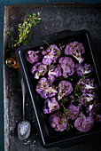Roasted purple cauliflower with thyme in oventray