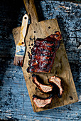 Spare Ribs glazed on wooden cuttingboard