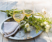 Glasses of Sparkling Wine on outdoor table with