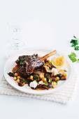 Foil-baked lamb shanks with warm eggplant salad