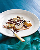 Crepes with bananas, chocolate sauce and chantilly